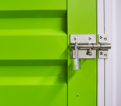 close up of door with slide lock and padlock