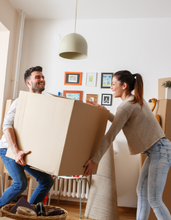 couple carrying boxes for self storage