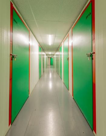 green doors corridor in tameside storage centre